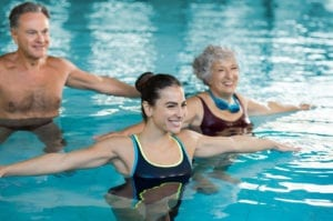 Seniors enjoying the benefits of swimming pool exercises